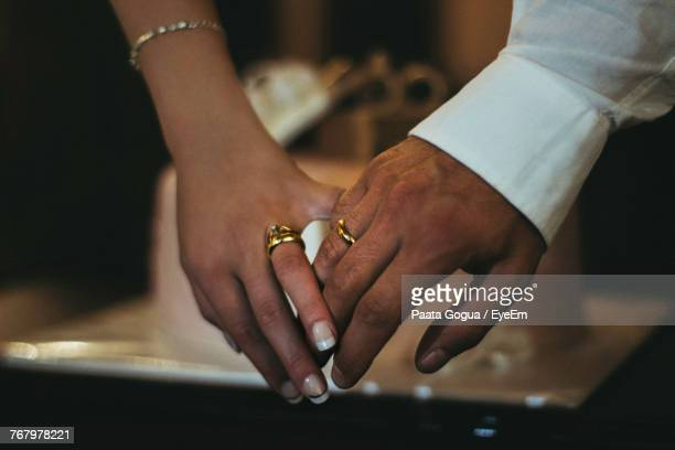 Close-Up Of Couple Showing Rings