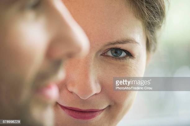 Close-up of couple, woman smiling at camera