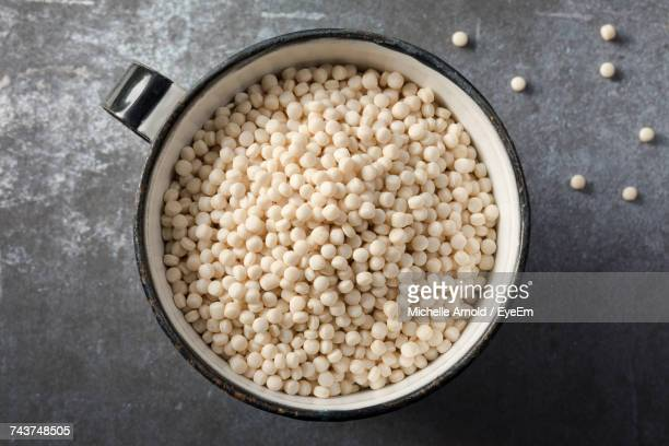 close-up of couscous in bowl on table - couscous stock pictures, royalty-free photos & images