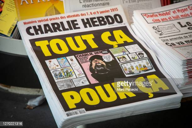 Close-up of covers of the french satirical weekly Charlie Hebdo reading 'All of this, just for that' published on September 2 as the trial for 14...