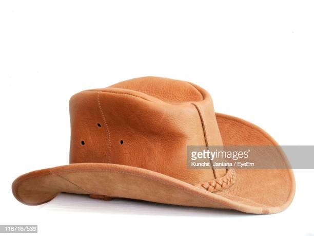 close-up of cowboy hat over white background - cowboy hat stock pictures, royalty-free photos & images