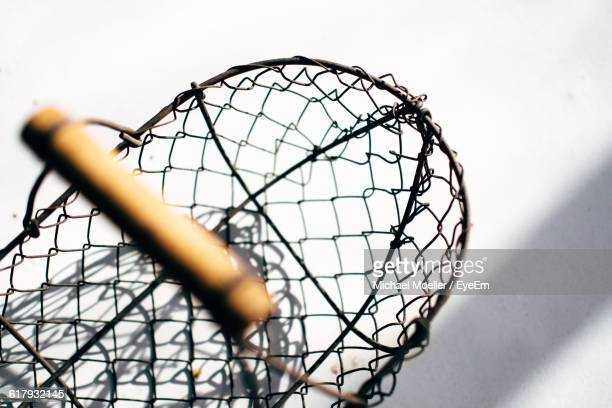 close-up of crab pot against white wall - crab pot stock photos and pictures