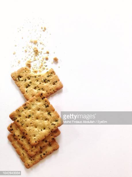 close-up of crackers on white background - cracker snack stock photos and pictures