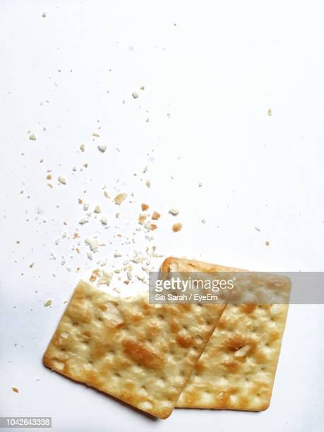 close-up of crackers on white background - クラッカー ストックフォトと画像