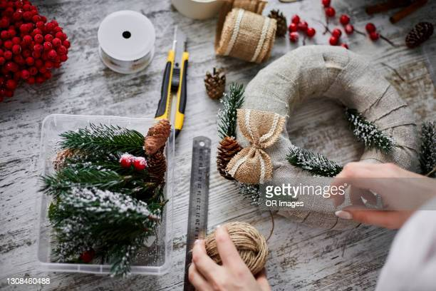 close-up of craftswoman making advent wreath - craft stock pictures, royalty-free photos & images