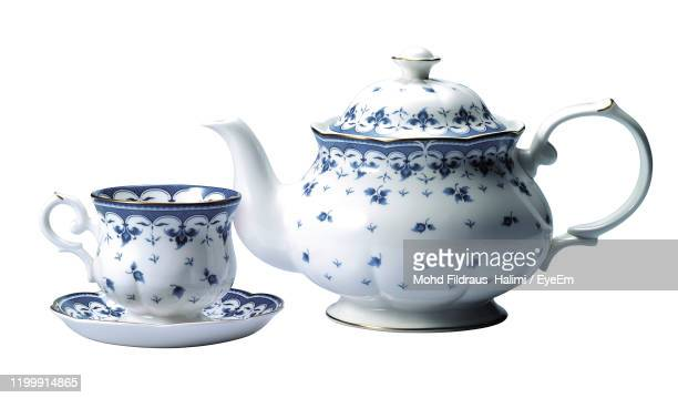 close-up of crcockery against white background - porcelain stock pictures, royalty-free photos & images