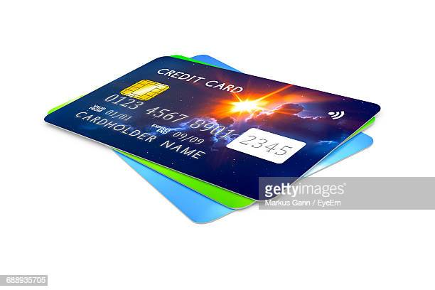 Close-Up Of Credit Cards On White Background
