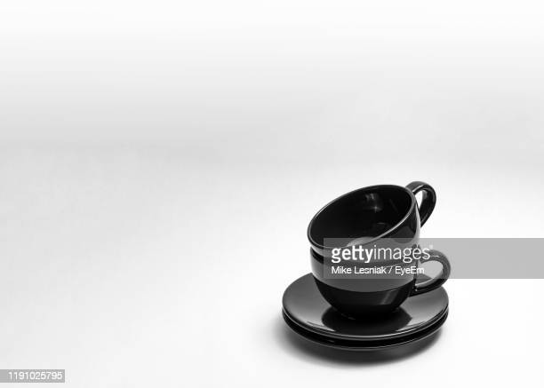 close-up of crockery over white background - silhouette stock pictures, royalty-free photos & images