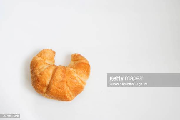 Close-Up Of Croissant Against White Background