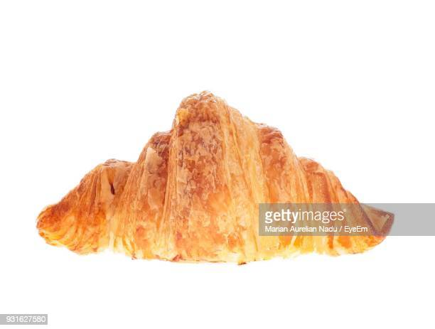 close-up of croissant against white background - croissant stock pictures, royalty-free photos & images
