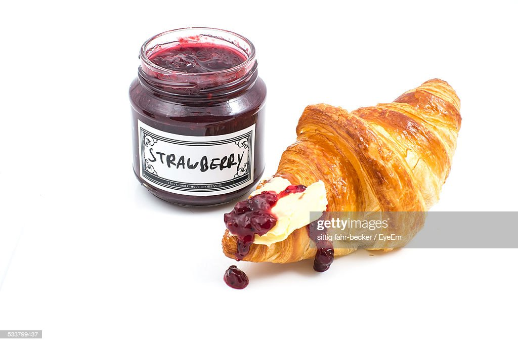 Close-Up Of Croissant And Strawberry Jam : Stock Photo