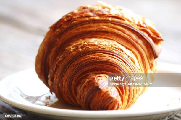 close-up of croissant served in plate - croissant stock pictures, royalty-free photos & images