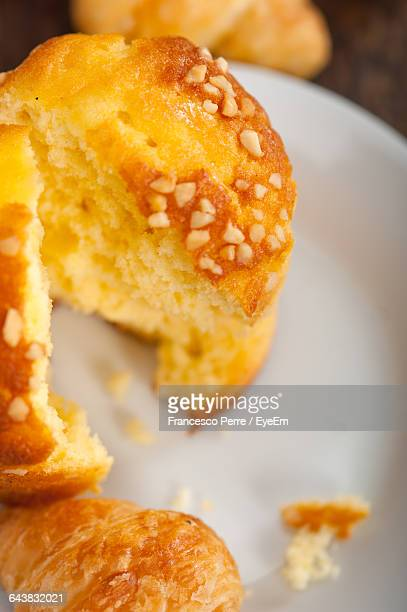 Close-Up Of Croissants And Muffins In Plate