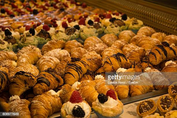 Close-Up Of Croissants For Sale At Bakery Shop