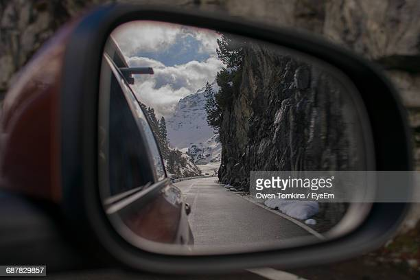close-up of cropped car on road - side view mirror stock photos and pictures