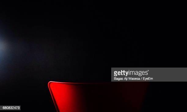 Close-Up Of Cropped Chair Over Black Background