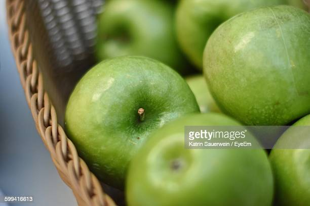 Close-Up Of Cropped Green Apples