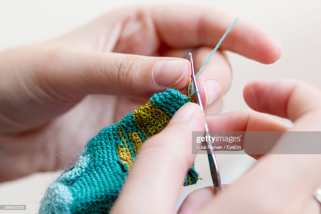 Close-Up Of Cropped Hand Crocheting : Stock Photo