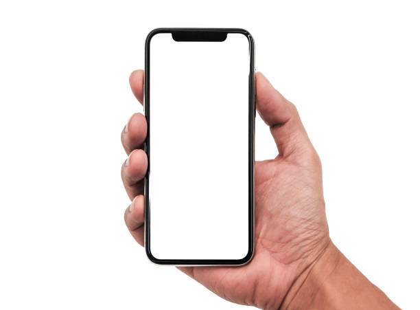 close-up of cropped hand holding mobile phone against white background - hand stock pictures, royalty-free photos & images