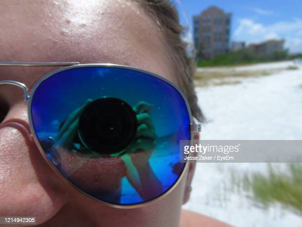 close-up of cropped hand holding sunglasses - jesse stock pictures, royalty-free photos & images