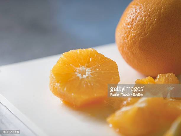 Close-Up Of Cropped Oranges On Table