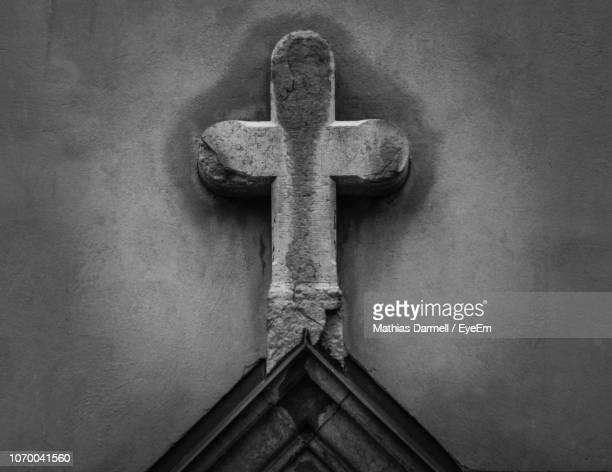close-up of cross on church - religious symbol stock pictures, royalty-free photos & images