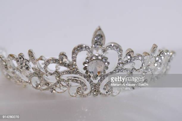 close-up of crown against white background - crown close up stock pictures, royalty-free photos & images