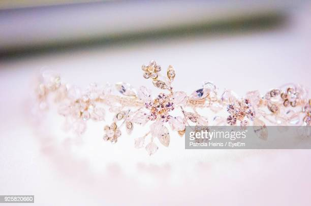 close-up of crown on table - crown close up stock pictures, royalty-free photos & images