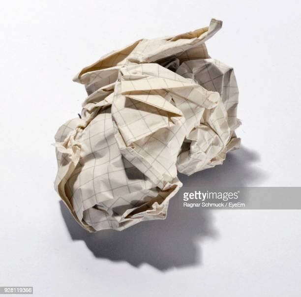 Close-Up Of Crumpled Paper Against White Background