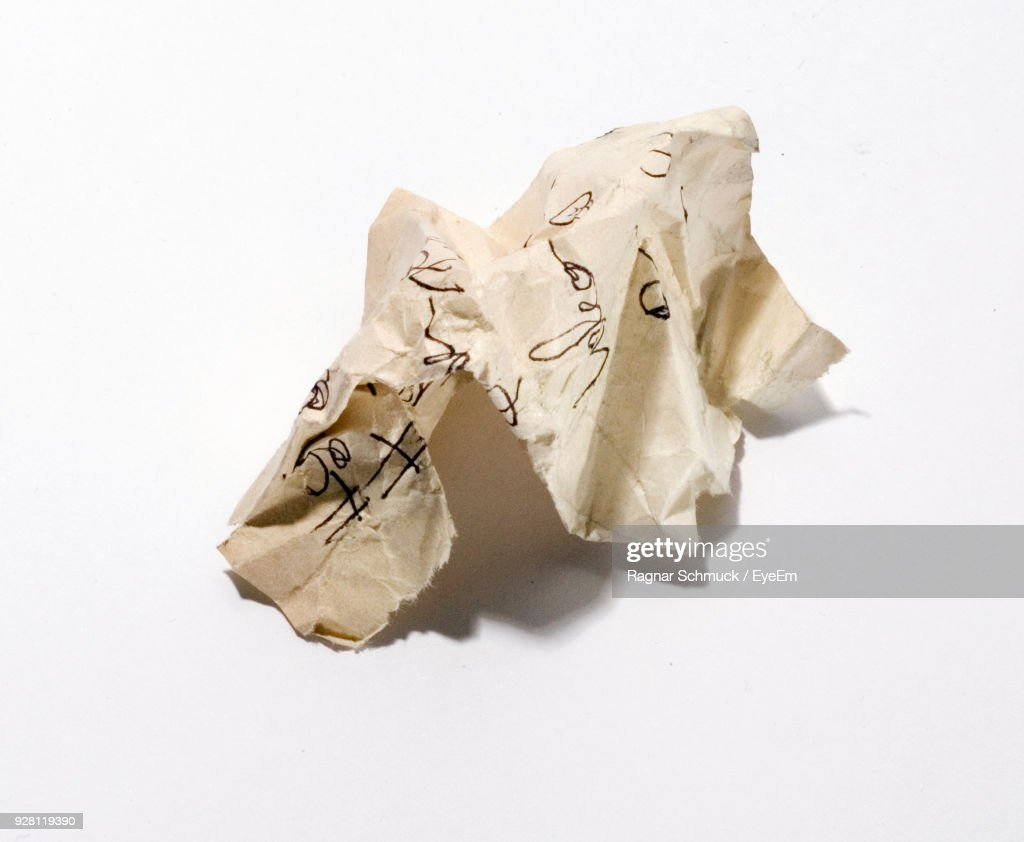 Close-Up Of Crumpled Paper Against White Background : Stock Photo