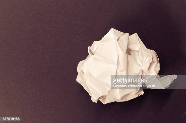 Close-Up Of Crumpled Paper Ball On Table