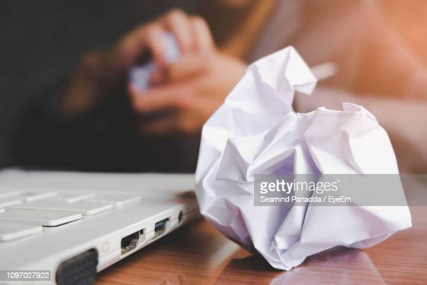 close-up of crumpled paper on table - selective focus stock pictures, royalty-free photos & images
