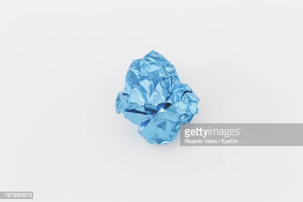 Close-Up Of Crumpled Paper Over White Background