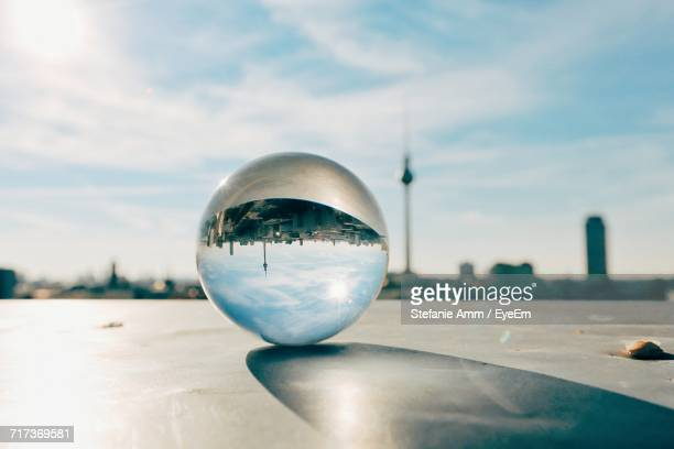 Close-Up Of Crystal Ball Against Sky