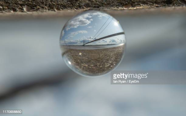close-up of crystal ball on land - kingston upon hull stock pictures, royalty-free photos & images