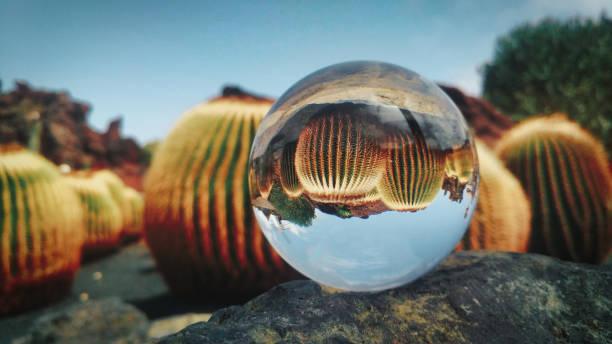 Close-up of crystal ball on rock against sky,Guatiza,Las Palmas,Spain