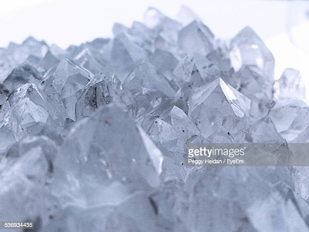 Close-Up Of Crystal Rocks Against White Background