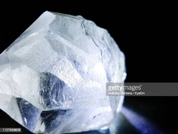 close-up of crystal stone against black background - quartz stock pictures, royalty-free photos & images