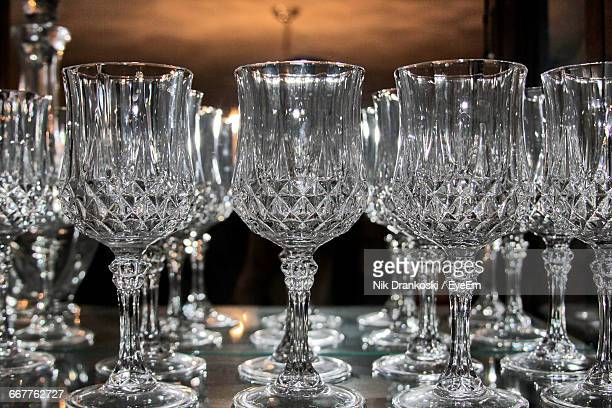 close-up of crystal wineglasses on table - kristallglas stock-fotos und bilder