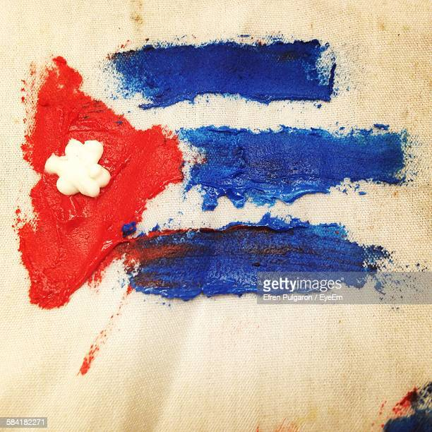Close-Up Of Cuban Flag Painted On Fabric