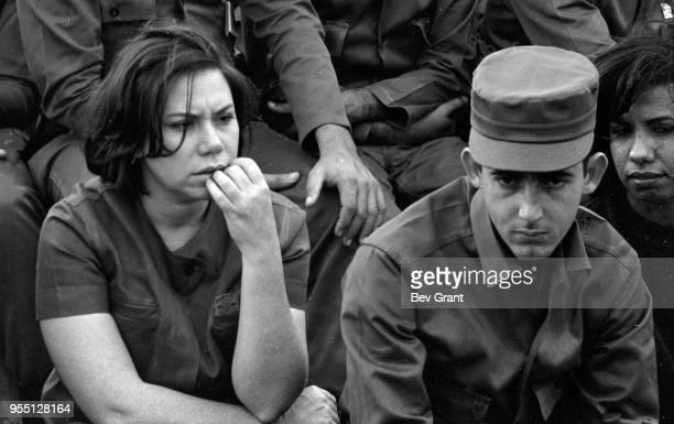 Closeup of Cuban soldiers in the audience in la Plaza de la Revolucion during the 10th anniversary celebration of the Cuban Revolution Havana Cuba...