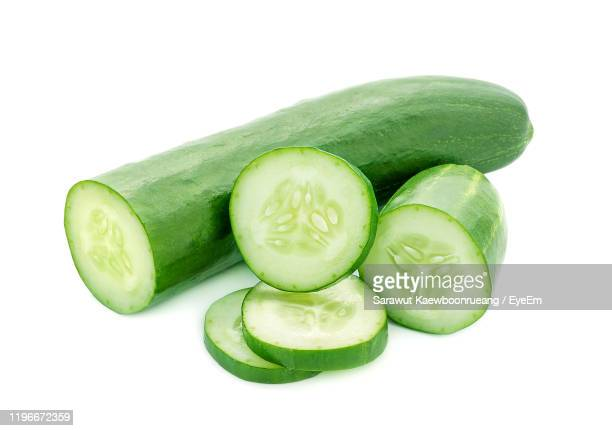 close-up of cucumber against white background - cucumber stock pictures, royalty-free photos & images