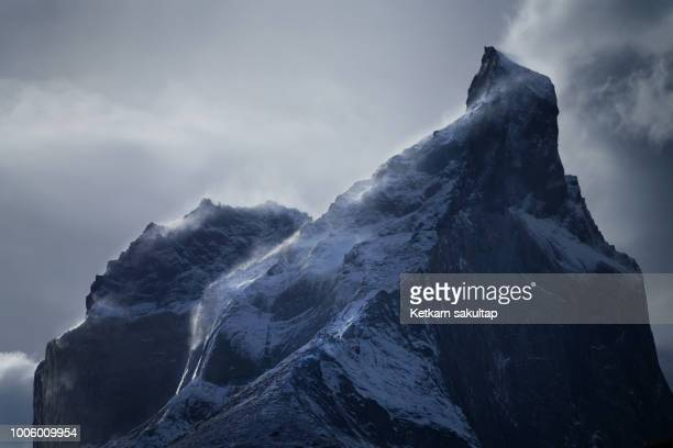 Close-up of Cuernos del paine mountain peak with strong wind.