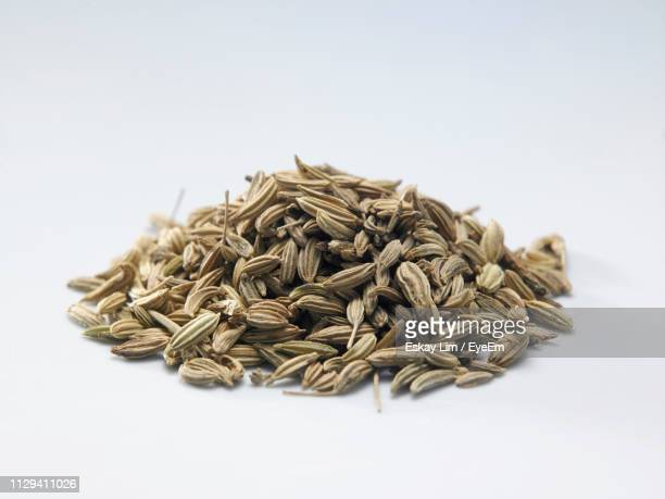 Close-Up Of Cumin Seeds Over White Background