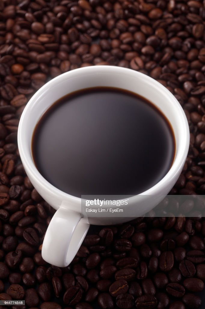 Close-Up Of Cup And Roasted Coffee Beans : Stock Photo