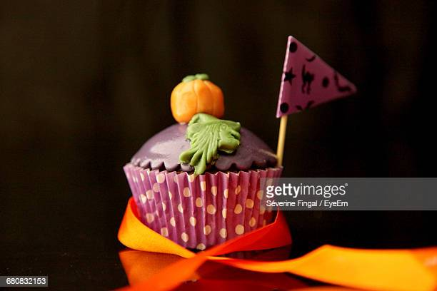 Close-Up Of Cup Cake Over Black Background