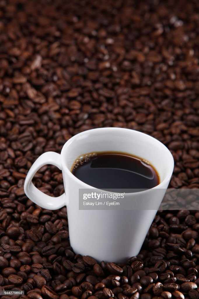 Close-Up Of Cup With Roasted Coffee Beans : Stock Photo