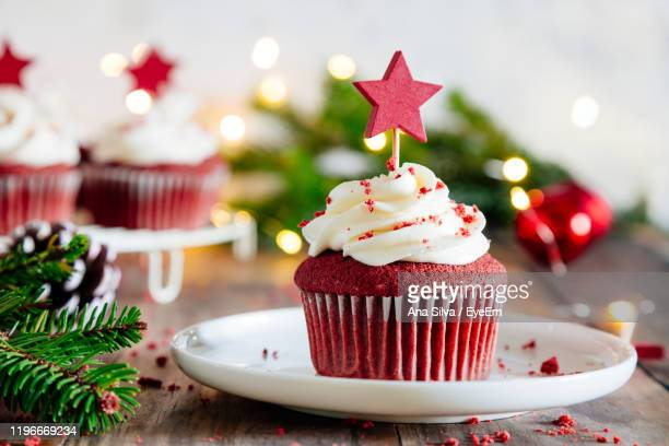 close-up of cupcake on table during christmas - デザート ストックフォトと画像