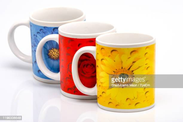 close-up of cups against white background - shaifulzamri stock pictures, royalty-free photos & images