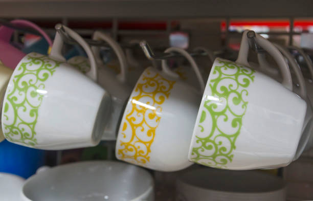 Close-Up Of Cups Hanging At Store